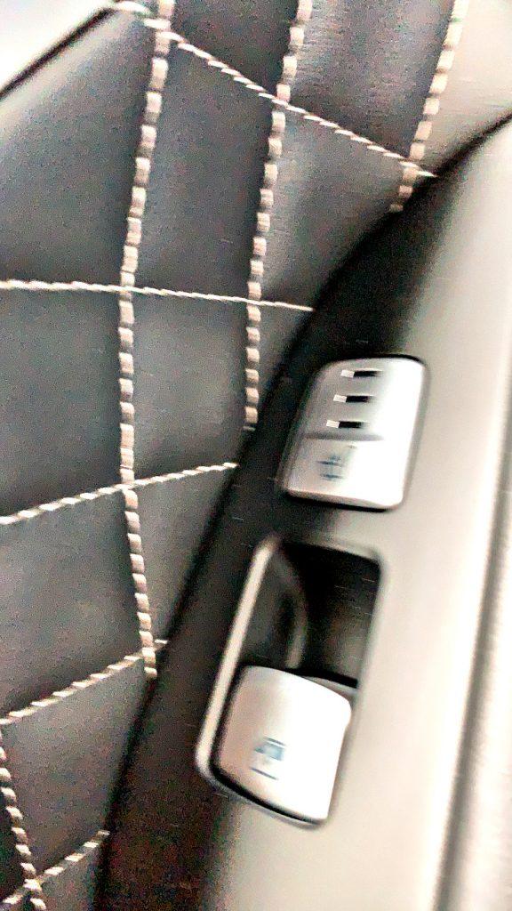 heated seat controls on door arm rest
