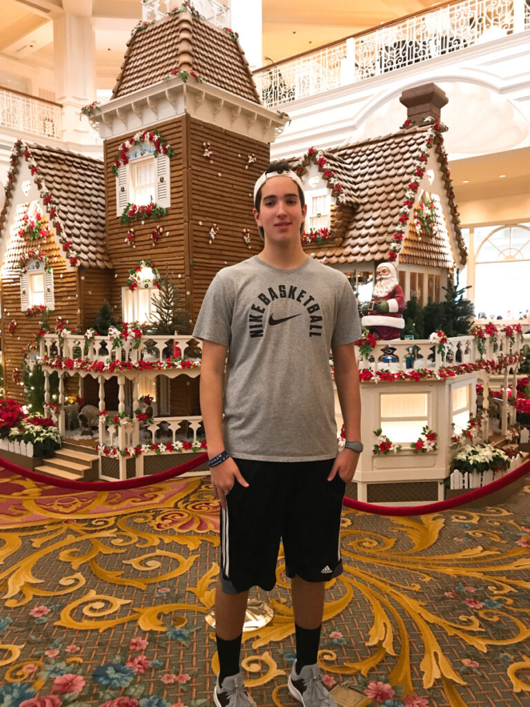 Lucas in front of Gingerbread house