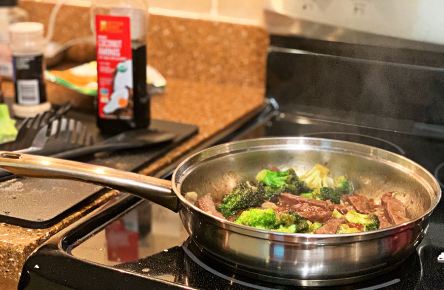 cooking the keto beef and broccoli